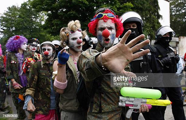 Antiglobalisation activists take part in a demonstration against refugee policy in the Group of Eight club of rich nations 04 June 2007 in Rostock...