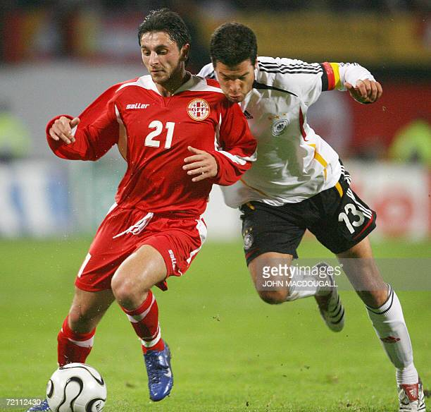 Germany's Michael Ballack vies for the ball against Georgia's Otar Martsvaladze during the Germany vs Georgian friendly football match at the Ostsee...