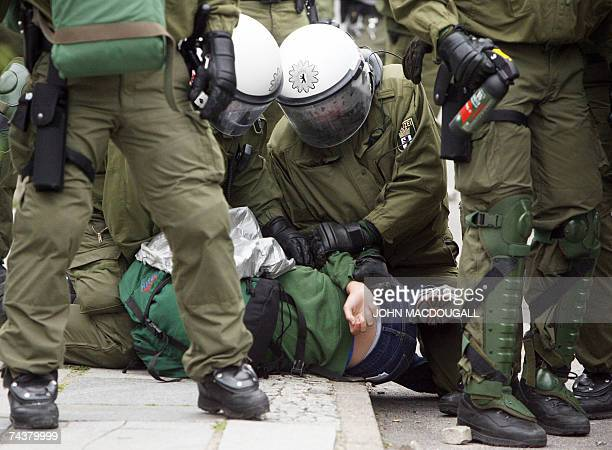 Riot police officers detain an antiG8 protester during unrest between police and anti G8 demonstrators in Rostock 02 June 2007 Several hundred...