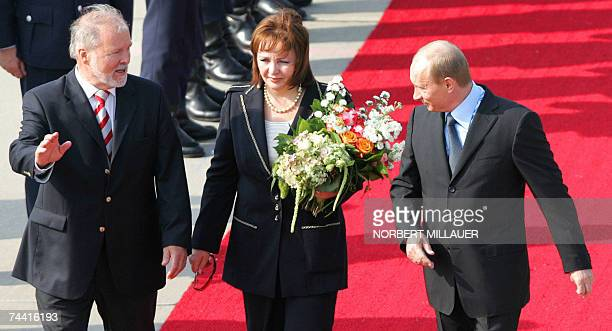 Russian President Vladimir Putin and his wife Lyudmila Putina are welcomed by MecklenburgWestern Pomerania's State Premier Harald Ringstorff at the...