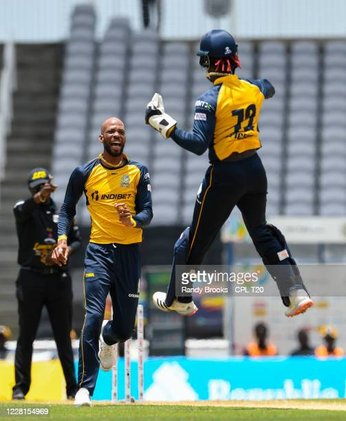 Roston Chase and Andre Fletcher of St Lucia Zouks celebrates the dismissal of Evin Lewis of St Kitts & Nevis Patriots during the Hero Caribbean...