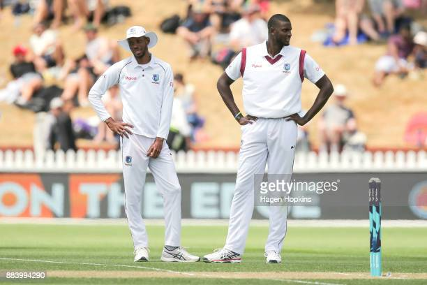 Roston Chase and Jason Holder of the West Indies look on in disappointment after Henry Nicholls of New Zealand is ruled not out during day two of the...
