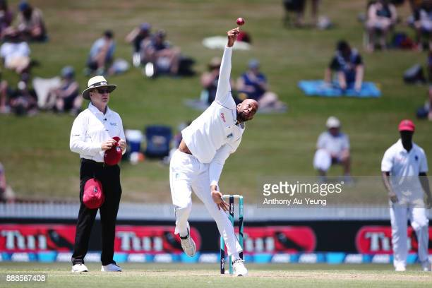 Roston Chase of the West Indies bowls during day one of the second Test match between New Zealand and the West Indies at Seddon Park on December 9...