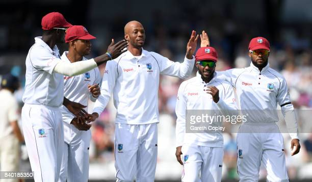 Roston Chase of the West Indies celebrates with teammates after dismissing Ben Stokes of England during day four of the 2nd Investec Test between...