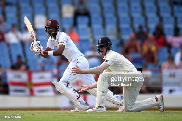 Roston Chase of the West Indies plays a shot past Keaton Jennings of England during Day Four of the Third Test match between the West Indies and...