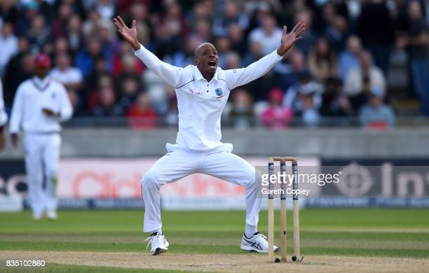 Roston Chase of the West Indies successfully appeals for the wicket of Alastair Cook of England during day two of the 1st Investec Test match between...