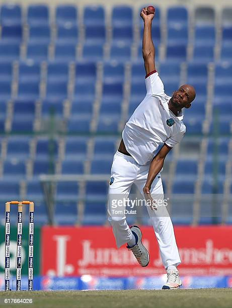 Roston Chase of West Indies bowls during Day Four of the Second Test between Pakistan and West Indies at Zayed Cricket Stadium on October 24 2016 in...