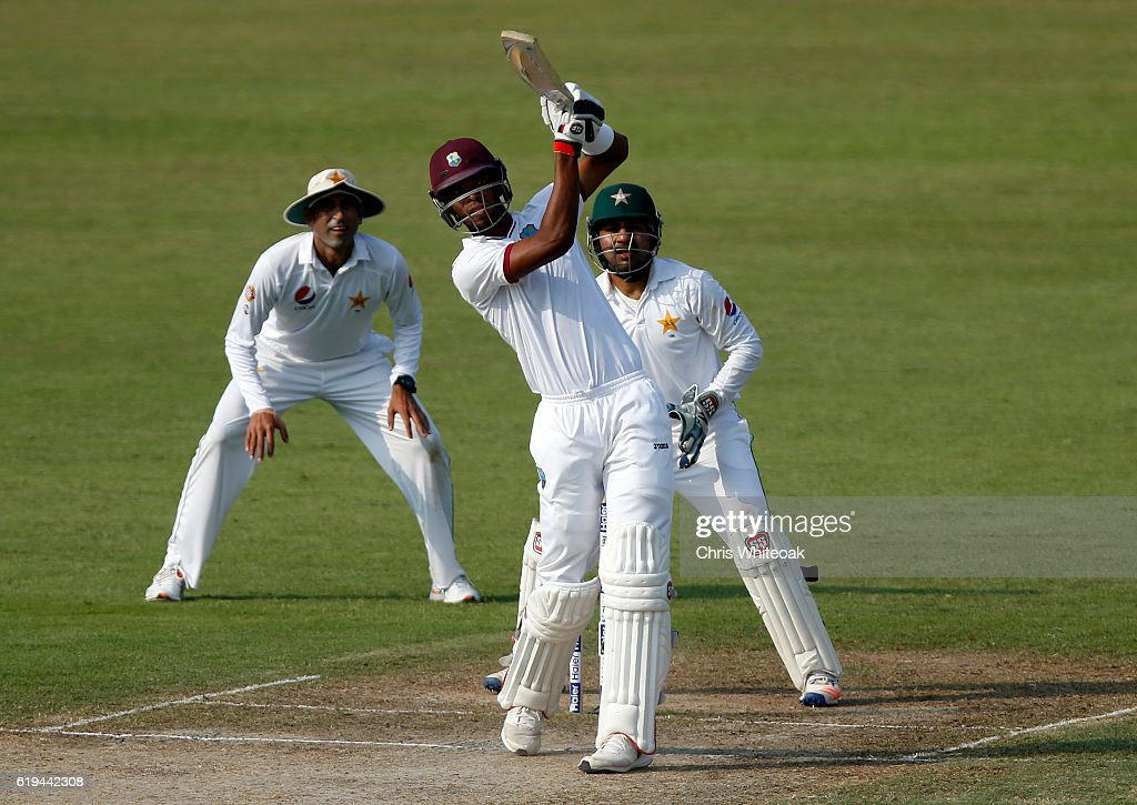 Roston Chase of West Indies brings up his 50 with a 6 on day two of the third test between Pakistan and West Indies at Sharjah Cricket Stadium on October 31, 2016 in Sharjah, United Arab Emirates.