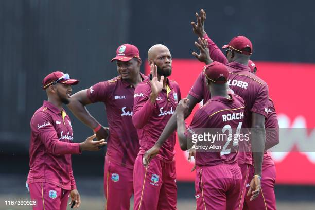 Roston Chase of West Indies celebrate a wicket with his teammates during the second MyTeam11 ODI between the West Indies and India at the Queen's...