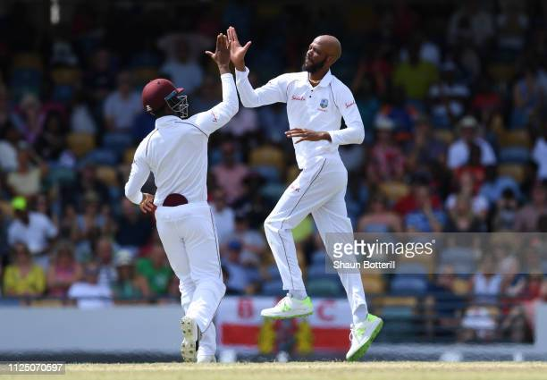Roston Chase of West Indies celebrates after taking the wicket of Rory Burns of England during Day Four of the First Test match between England and...