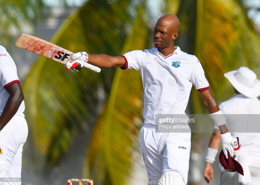 Roston Chase of West Indies celebrates his century during the 1st day of the 2nd Test match between West Indies and Pakistan at Kensington Oval, Bridgetown, Barbados, April 30, 2017. / AFP PHOTO / Randy BROOKS