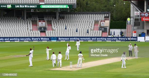 Roston Chase of West Indies celebrates taking the wicket of Rory Burns of England with teammates during Day One in the 2nd Test Match of the...