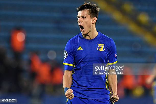 Rostov's forward Dmitri Poloz celebrates after scoring a goal during the Champions League group D football match between Rostov and PSV Eindhoven in...