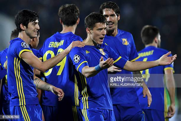 Rostov's forward Dmitri Poloz celebrates with teammates after scoring a goal during the Champions League group D football match between Rostov and...