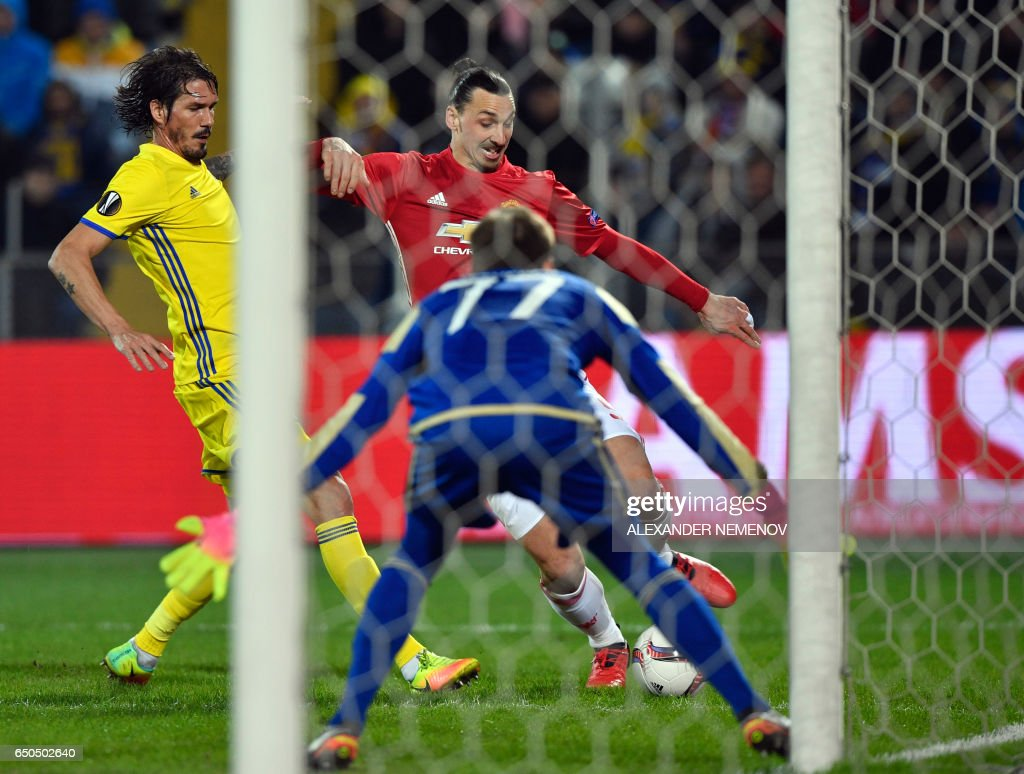 Rostov's Spanish defender Cesar Navas (L) and Rostov's Russian goalkeeper Nikita Medvedev (C) fail to stop a goal by Manchester United's Swedish forward Zlatan Ibrahimovic (back) during the UEFA Europa League round of 16 football match between Rostov and Manchester United at Olimp-2 Arena in Rostov-on-Don on March 9, 2017. PHOTO / Alexander NEMENOV