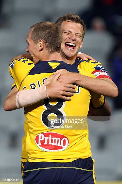 Rostyn Griffiths and Alex Wilkinson of the Mariners celebrates after Griffiths scored a goal during the round nine A-League match between Adelaide...