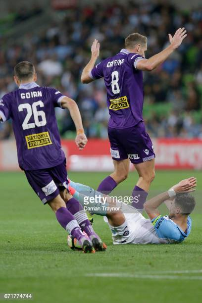 Rostyn Griffiths of Perth Glory takes down Bruno Fornaroli of Melbourne City during the ALeague Elimination Final match between Melbourne City FC and...
