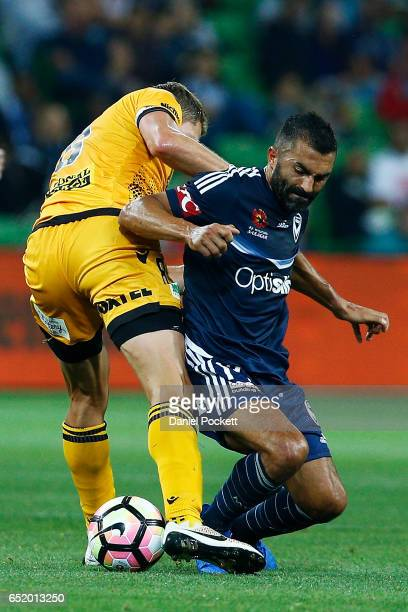Rostyn Griffiths of the Glory and Fahid Ben Khalfallah of the Victory contest the ball during the round 23 ALeague match between Melbourne City FC...