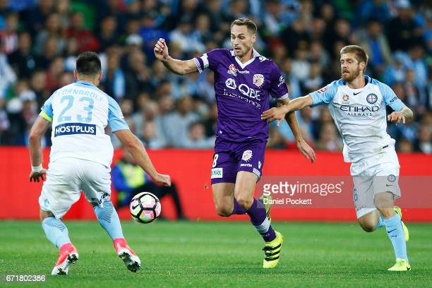 Rostyn Griffiths of the Glory and Luke Brattan of Melbourne City compete for the ball during the ALeague Elimination Final match between Melbourne...
