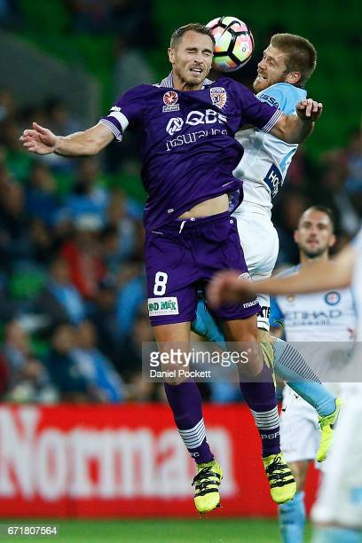 Rostyn Griffiths of the Glory and Luke Brattan of Melbourne City contest the ball during the ALeague Elimination Final match between Melbourne City...
