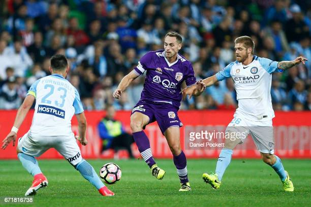 Rostyn Griffiths of the Glory and Luke Brattan of Melbourne City during the ALeague Elimination Final match between Melbourne City FC and the Perth...