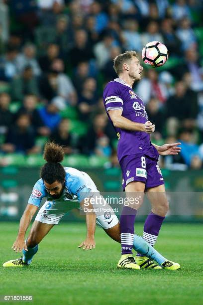 Rostyn Griffiths of the Glory and Osama Malik of Melbourne City contest the ball during the ALeague Elimination Final match between Melbourne City FC...