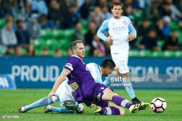 Rostyn Griffiths of the Glory and Tim Cahill of Melbourne City compete for the ball during the ALeague Elimination Final match between Melbourne City...