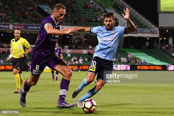Rostyn Griffiths of the Glory controls the ball against Milos Ninkovic of Sydney during the round 11 ALeague match between Perth Glory and Sydney FC...