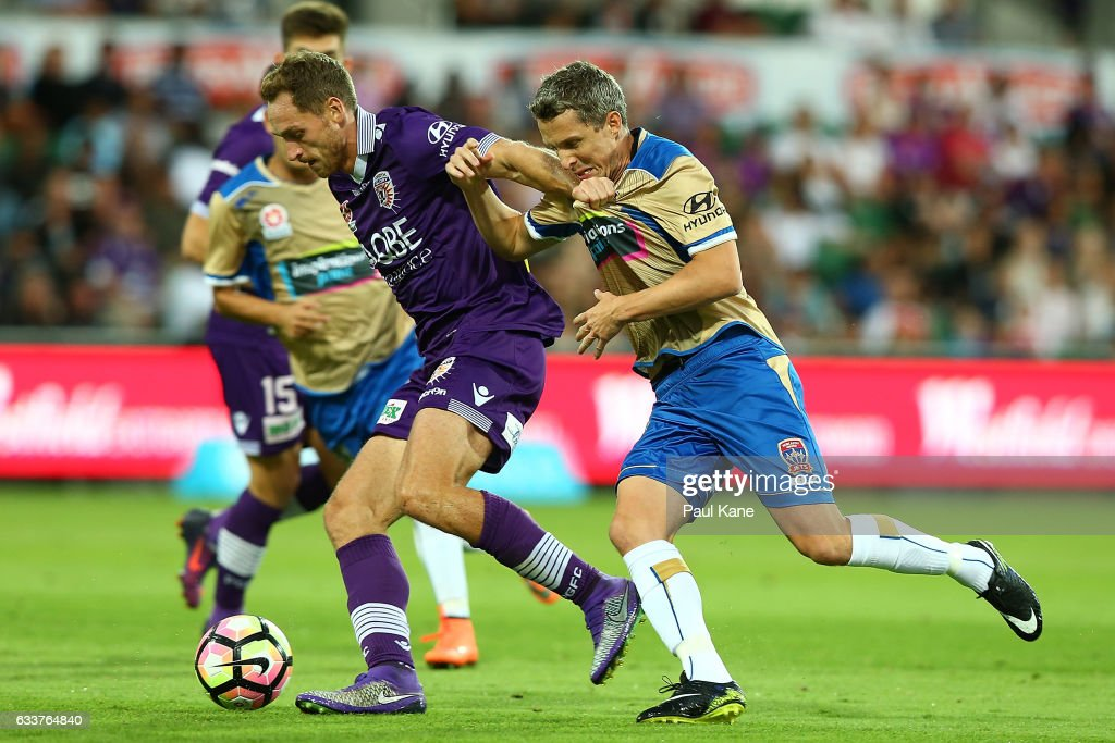 Rostyn Griffiths of the Glory holds off Morten Nordstrand of the Jets in a contest for the ball during the round 18 A-League match between the Perth Glory and the Newcastle Jets at nib Stadium on February 4, 2017 in Perth, Australia.