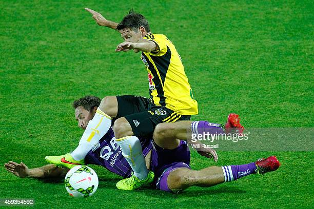 Rostyn Griffiths of the Glory is brought down by Nathan Burns of the Phoenix during the round seven A-League match between Perth Glory and Wellington...