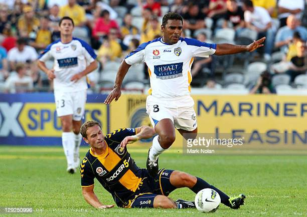 Rostyn Griffiths of the Mariners tackles Robson of the Gold Coast during the round two ALeague match between the Central Coast Mariners and Gold...
