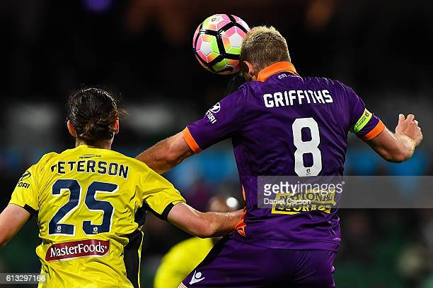 Rostyn Griffiths of the Perth Glory attempts to header in a shot at goal during the round one ALeague match between the Perth Glory and the Central...