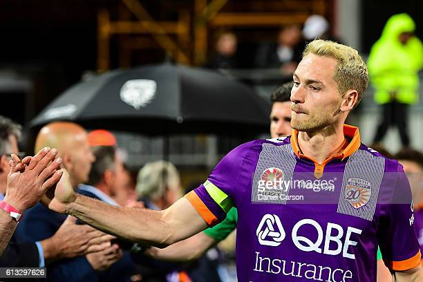 Rostyn Griffiths of the Perth Glory enters the arena through the guard of honour made by 1996 past Glory players during the round one ALeague match...