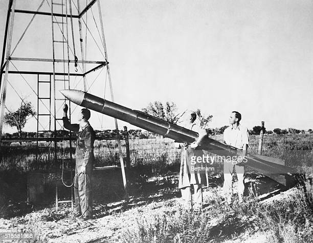 Early space rocket designed by Dr Robert Goddard is prepared for launching at Mescalero ranch Roswell NM Photograph 1935