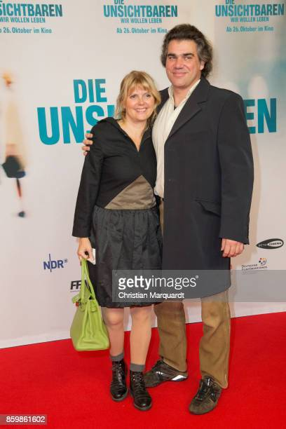 Roswitha Schreiner and Andreas Gotzler attend the premiere of 'Die Unsichtbaren' at Kino International on October 10 2017 in Berlin Germany