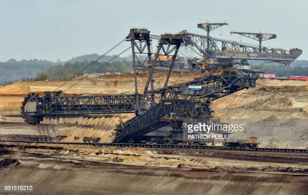 A rotary excavator stands still at the opencast mine Welzow Sued in Welzow eastern Germany on May 15 2016 Members of antinuclear and anticoal...