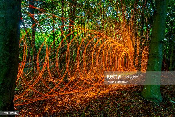 Rotating burning steel wool in forest