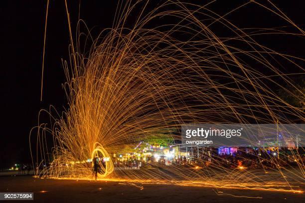 Rotating burning steel wool