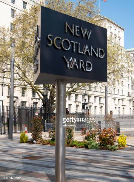 rotating sign outside new scotland yard metropolitan police headquarters, london - new scotland yard stock pictures, royalty-free photos & images