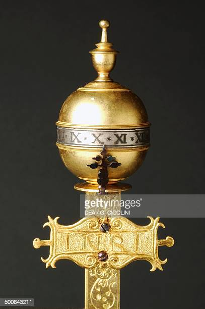 Rotating sphere that indicates the hours detail of a crucifixshaped gilt brass clock with cast moulded figures rocker arm mechanism on which is...