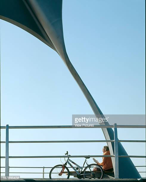 Rotating Wind Shelter, Blackpool, United Kingdom, Architect Mcchesney Architects, Rotating Wind Shelter With Woman And Bike.