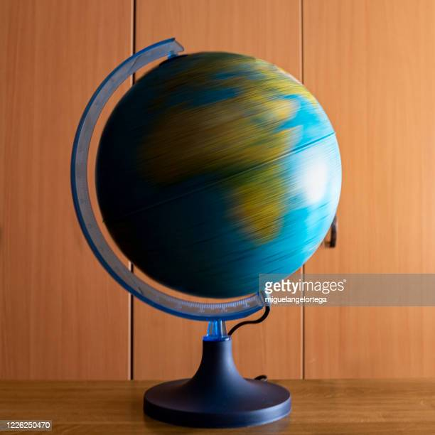 rotational motion of the earth - spinning stock pictures, royalty-free photos & images