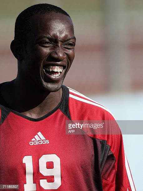 Trinidad and Tobago's forward Dwight Yorke laughs during a training session at In der Ahe stadium in Rotenburg northern Germany 12 June 2006 Trinidad...