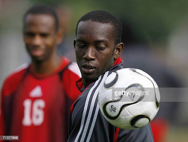 Trinidad and Tobago's forward Dwight Yorke eyes the ball during a training session at In der Ahe stadium in Rotenburg northern Germany 17 June 2006...