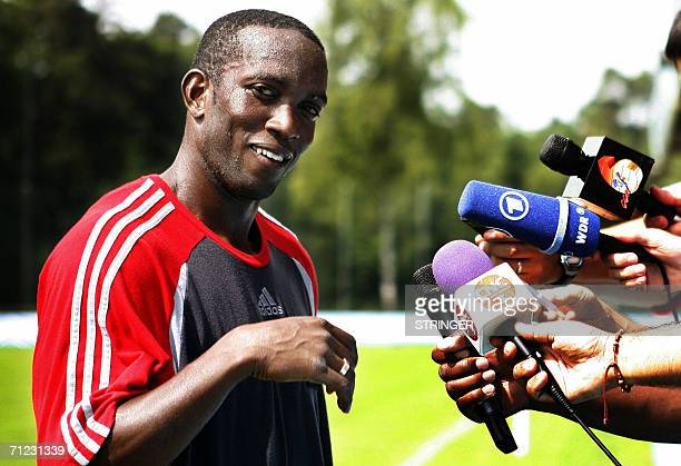 Trinidad and Tobago's forward Dwight Yorke former Manchester United player answers reporters' questions after a training session in Rotenburg...