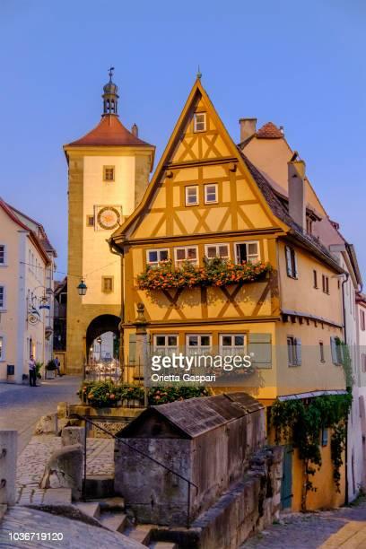 rothenburg ob der tauber, plönlein with kobolzeller steige and spitalgasse (bavaria, germany) - rothenburg stock photos and pictures