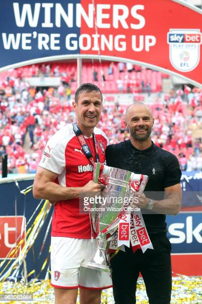 Rotherham captain Richard Wood and manager Paul Warne pose with the trophy during the Sky Bet League One Play Off Semi FinalSecond Leg between...