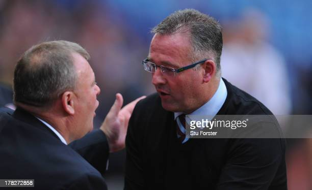 Rotherham manager Steve Evans chats with Villa manager Paul Lambert before the Capital One Cup second round match between Aston Villa and Rotherham...