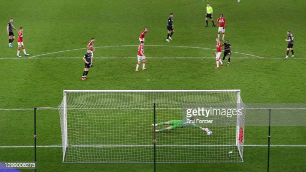 Rotherham striker Matt Crooks shoots to score the opening goal past the despairing dive of Boro goalkeeper Marcus Bettinelli during the Sky Bet...