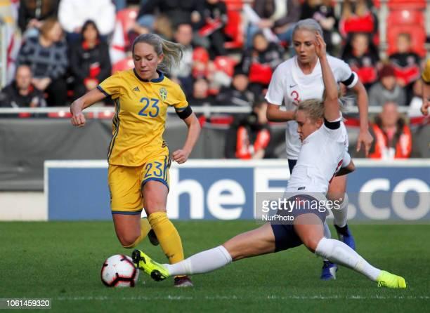 Rotherham UK 11 November 2018 Izzy Christianen tackles Elin Rubensson during Women's International match between England Women and Sweden Women at...